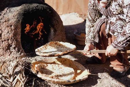 baking bread: Baking traditional bread in a natural clay oven in rural Morocco.