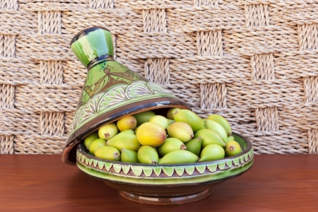 argan: Argan nuts from the Argan tree, that is cultivated for the oil  argan oil  which is found in the fruit  The oil is rich in fatty acids and is used in cooking and cosmetics  The argan tree is an endangered species.  Stock Photo