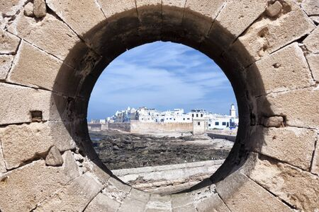 rampart: View of the coastal town Essaouira through a rampart hole