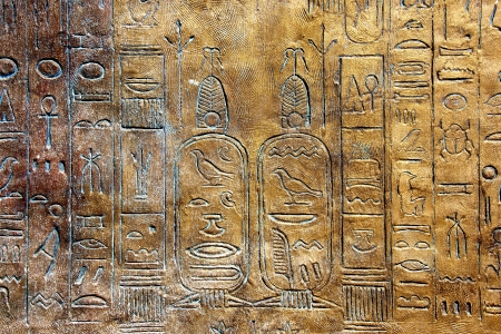 hieroglyphs: Ancient hieroglyphs on stone wall.  Stock Photo