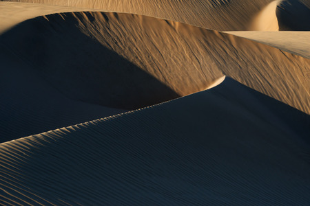 Abstract desert sand dunes at Lac Naila, Morocco.
