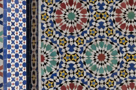 Traditional abstract Moroccan tile mosaic background. Architectural detail of the royal palace in Fes, Morocco. Stock Photo