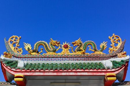 twin dragon in temple with blue sky photo