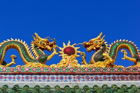 twin dragon in temple with blue sky Stock Photo - 9189710