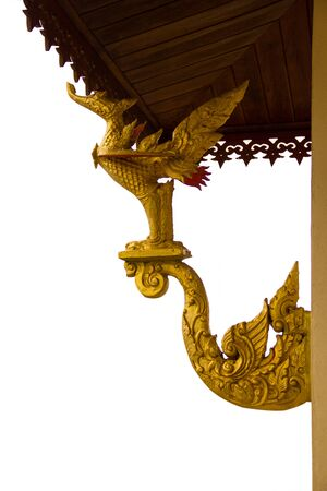 Golden swan statues adorned the architecture, isolated on the white background Stock Photo