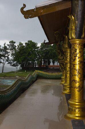 Chapel terrace Temple Phuproud Ubon Ratchathani Thailand. At that time it was raining.