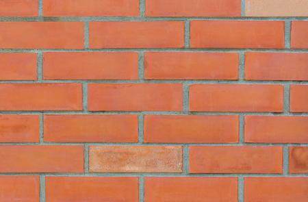 Clay brick wall textured background.