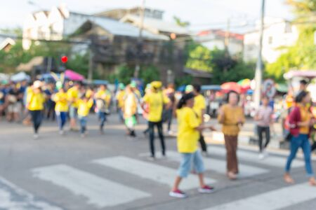 Image blur, the crowds were marching in the parade of the carnival on the streets joyfully.