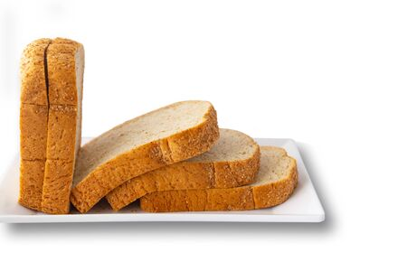 Sliced bread in a white tray, isolated on a white background. Archivio Fotografico