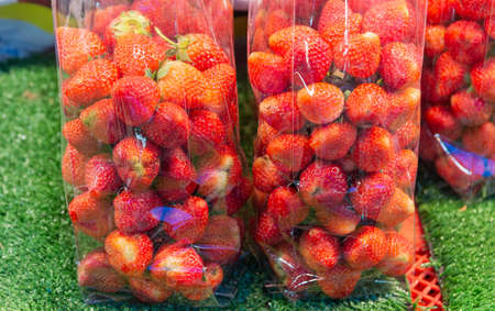 Strawberry packed in a clear plastic bag For sale in the fresh market in Thailand.
