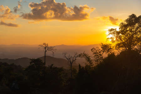A beautiful evening sunset over the mountains In Nan Province, Thailand Stock Photo