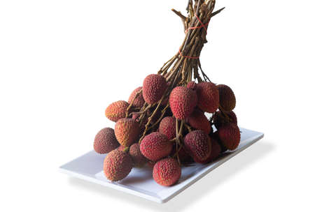 Lychee fruit in white tray isolated on white background.