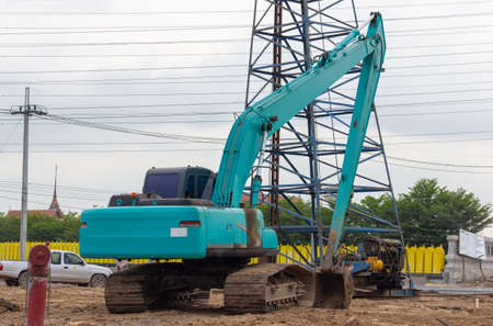 The blue excavator is parked at the construction site.