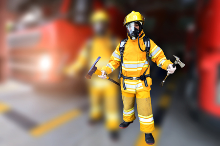 protective suit: Fireman , Firefighter holding axe  and Hammer air pack fully protective suit walking