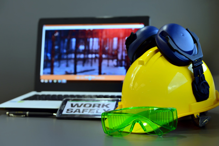 Safety in construction Concept , Hard hat on working table in construction  ,work outdoor wear safety equipment . Zdjęcie Seryjne
