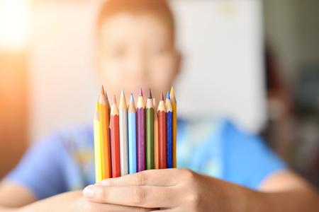 pencil in boy hands.
