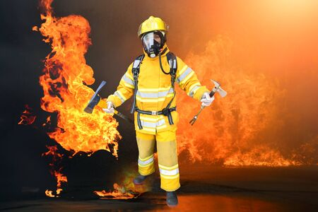 Fireman , Firefighter holding axe  and Hammer air pack fully protective suit walking