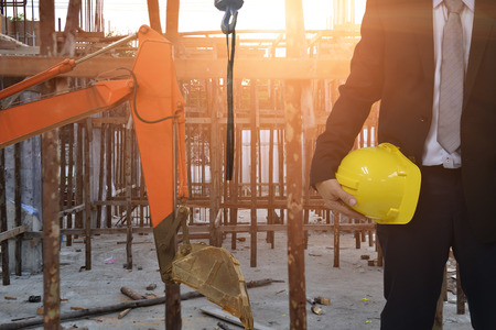 Work safety concept : work out door at construction site during used personal protective equipment   by hard hat . Stock Photo
