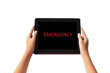 Emergency Concept.   EMERGENCY   words in red  color on tabled in boy hands on black background.