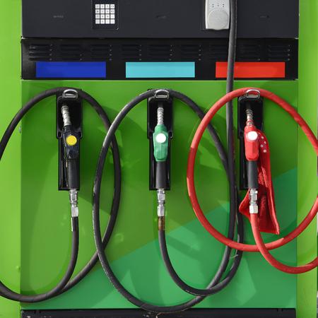 Filling gasoline in fuel station.