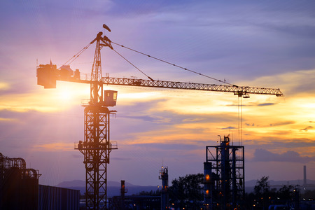 light duty: oil refinery plant in construction and sunset . Editorial