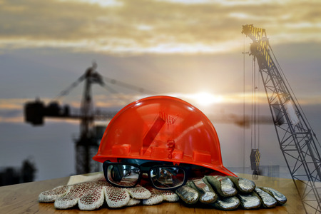 oil and gas industry: Set of safety work wear on  construction background ,Work safety at construction site concept