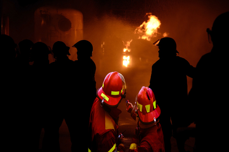 Emergency ,Several firefighters go offensive for a fire attack .
