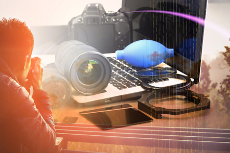 Double exposure of Digital camera, lens , laptop and Accessories for Landscape and silhouette photographer , concept of photographer work station.