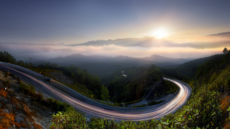 blue background: The Long road in to nature , morning mist sunrise at  Doi  Inthanon, Chiang Mai, Thailand .