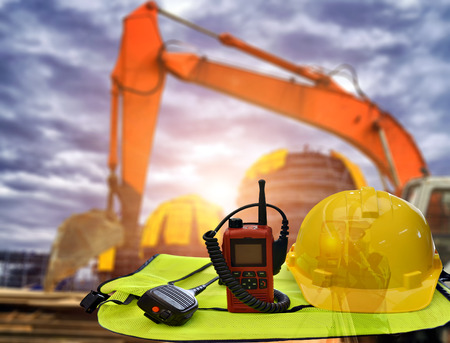 Security functions in construction site ,always wear safety equipment and personal protective equipment. Stock Photo