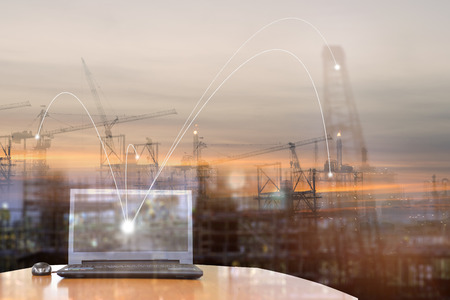 Double exposure of Office Equipment , network connection technology and  construction site.