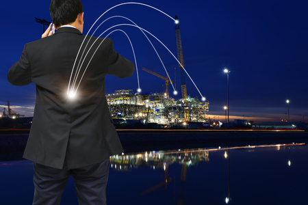 Double exposure of success businessman show his hand to success concept and construction site. Stock Photo