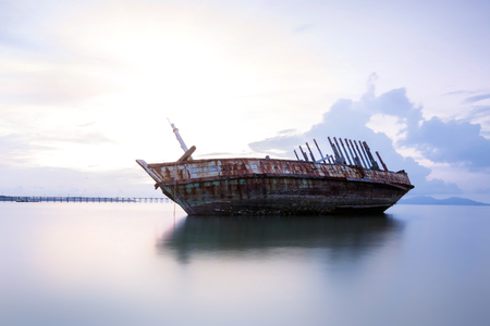 corrosion: An old shipwreck or abandoned shipwreck. , Wrecked boat abandoned stand on beach or Shipwrecked off the coast of Thailand. Stock Photo