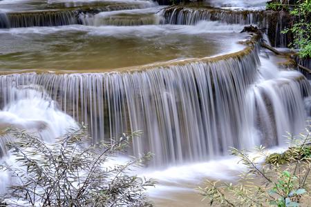 khamin: Waterfall in deep forest close up  Huai  Mae Khamin Waaterfall  , Kanchanaburi  Thailand is popular with waterfall tourists .