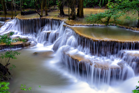 Waterfall in deep forest  Huai  Mae Khamin Waterfall  , Kanchanaburi  Thailand is popular with waterfall tourists .