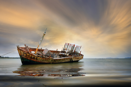ship wreck: An old shipwreck or abandoned shipwreck. , Wrecked boat abandoned stand on beach or Shipwrecked off the coast of Thailand. Stock Photo