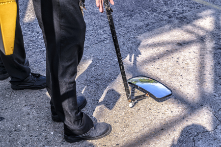 security guard used Inspection mirror for Bomb Squad, Military . Stock Photo
