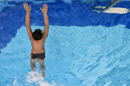 Boy swimming in the swimming pool , sport background . Stock Photo
