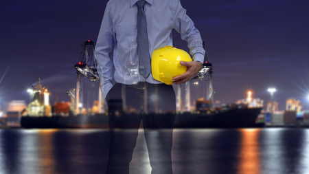 engineer holding yellow safety helmet .safety for logistic concept .