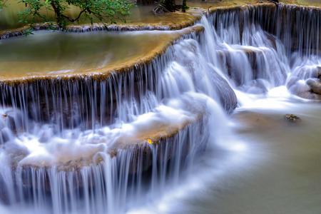 Waterfall in deep forest  Huai  Mae Khamin Waterfall  , Kanchanaburi  Thailand is popular with waterfall tourists . Close up to waterfall .