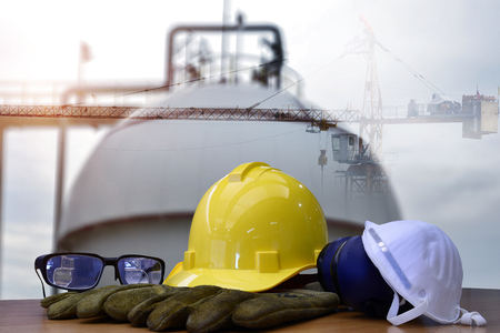 work outdoor wear safety equipment  at refinery construction site . Stock Photo - 97113898