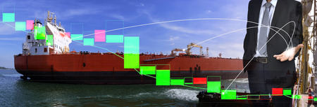 Young businessman ,Transportation Logistic , Crude oil vessels, pilot boats to dock loading products and technical bar chart . Logistic stock  market and management connection concept .