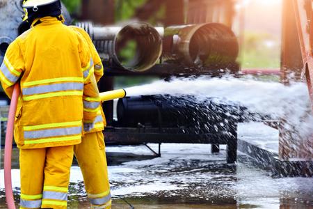 Firemen ,Fireman in action activated foam .
