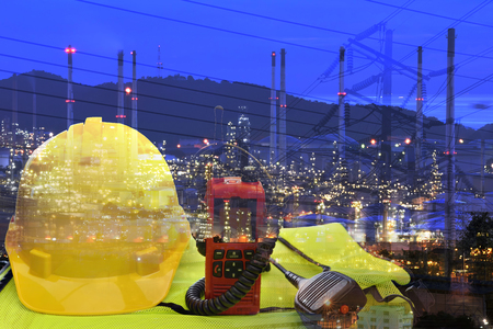 Double exposure of  safety standard and refinery background ,Work safety at construction site concept . Standard-Bild