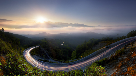 The Long road in to nature , morning mist sunrise at  Doi  Inthanon, Chiang Mai, Thailand