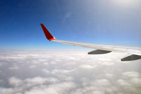 The outside view aircraft Wing look from the airplane cabin . Stock Photo - 97472586