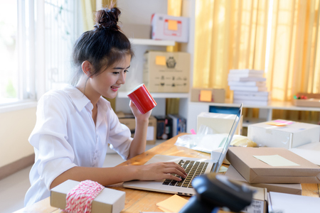 Young Asian Business Woman Working Business Online at home , Online Business ,Online Shopping and SME Business Concept. Stock Photo - 97472587