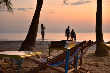 Beach chairs with sunset , Beautiful natural summer seascape Thailand .