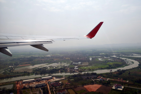 The outside view aircraft Wing look from the airplane cabin .