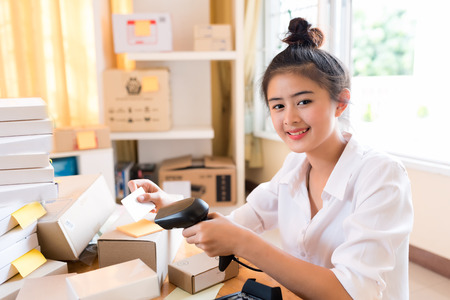 Young Asian Business Woman Working Business Online at home , Online Business ,Online Shopping and SME Business Concept.